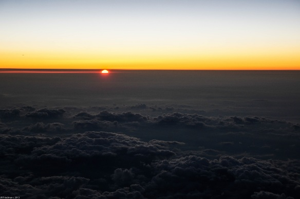 on the way to Boston, watching the sun set over the clouds