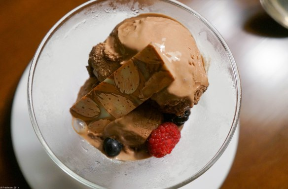 chocolate ice cream with fancy chocolate and berries