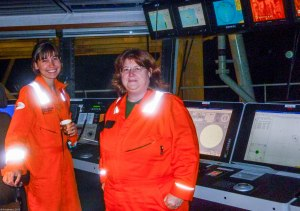 orange uniforms on the boat