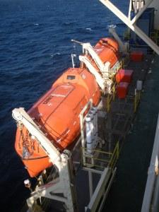 one more orange boat (lifeboat)